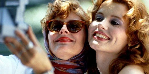 Thelma and Louise Susan Sarandon and Geena Davis taking a Polaroid