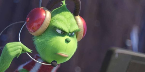 Dr. Seuss' The Grinch watching a monitor with his headset on