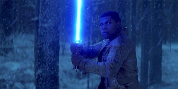 Finn with lightsaber in Star Wars: The Force Awakens
