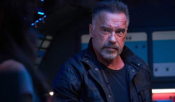 Terminator: Dark Fate Carl listens to someone during a conversation