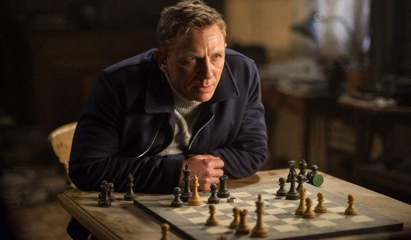 Spectre James Bond perched over chess board