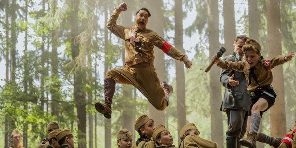 Hitler and Jojo leaping in Jojo Rabbit