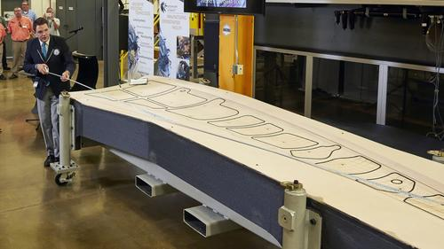 Guinness World Records judge measures the 3D-printed trim tool, co-developed by Oak Ridge National Laboratory and Boeing to be evaluated for use in constructing the wingskin of Boeing's new 777X passenger jet. (Source: Oak Ridge National Laboratory)