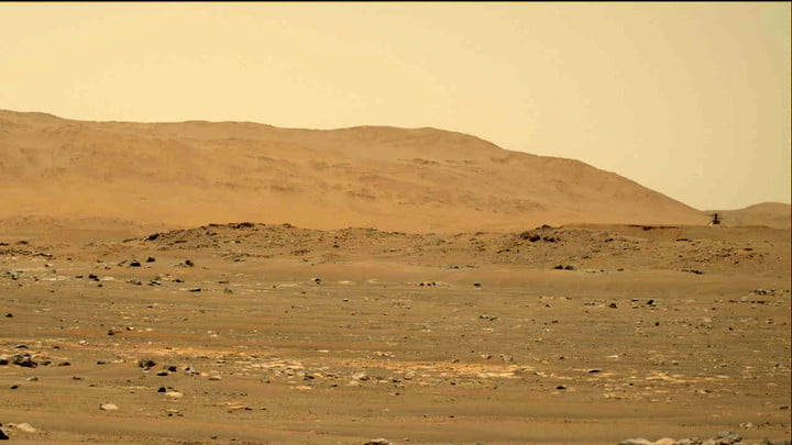 NASA's Mars Perseverance rover acquired this image of the Ingenuity Mars Helicopter (upper right) using its left Mastcam-Z camera. Mastcam-Z is a pair of cameras located high on the rovers mast. This is one still frame from a sequence captured by the camera while taking video. This image was acquired on Apr. 30, 2021 (Sol 69) at the Local Mean Solar Time of 12:33:27.