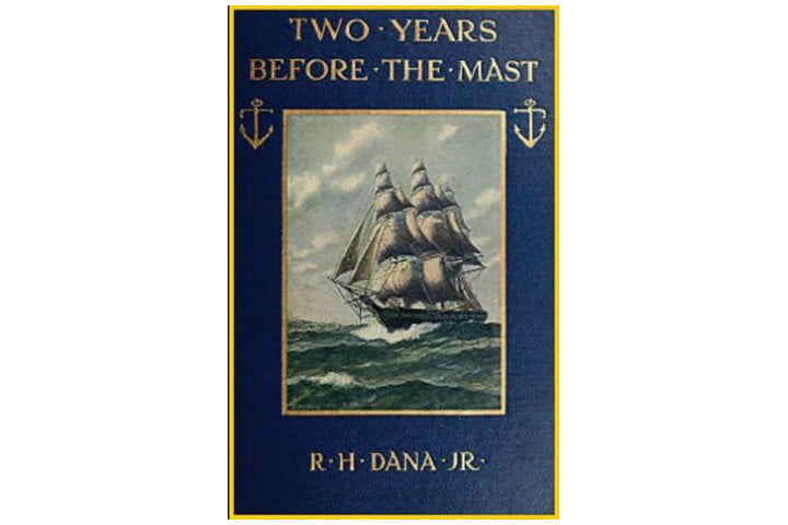 Picture shows the cover of the book in dark blue with gold writing, and a picture of a ship at sea in the center