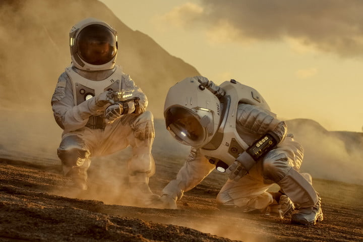 Two Astronauts Collect soil samples on mars Analyzing them - concept image