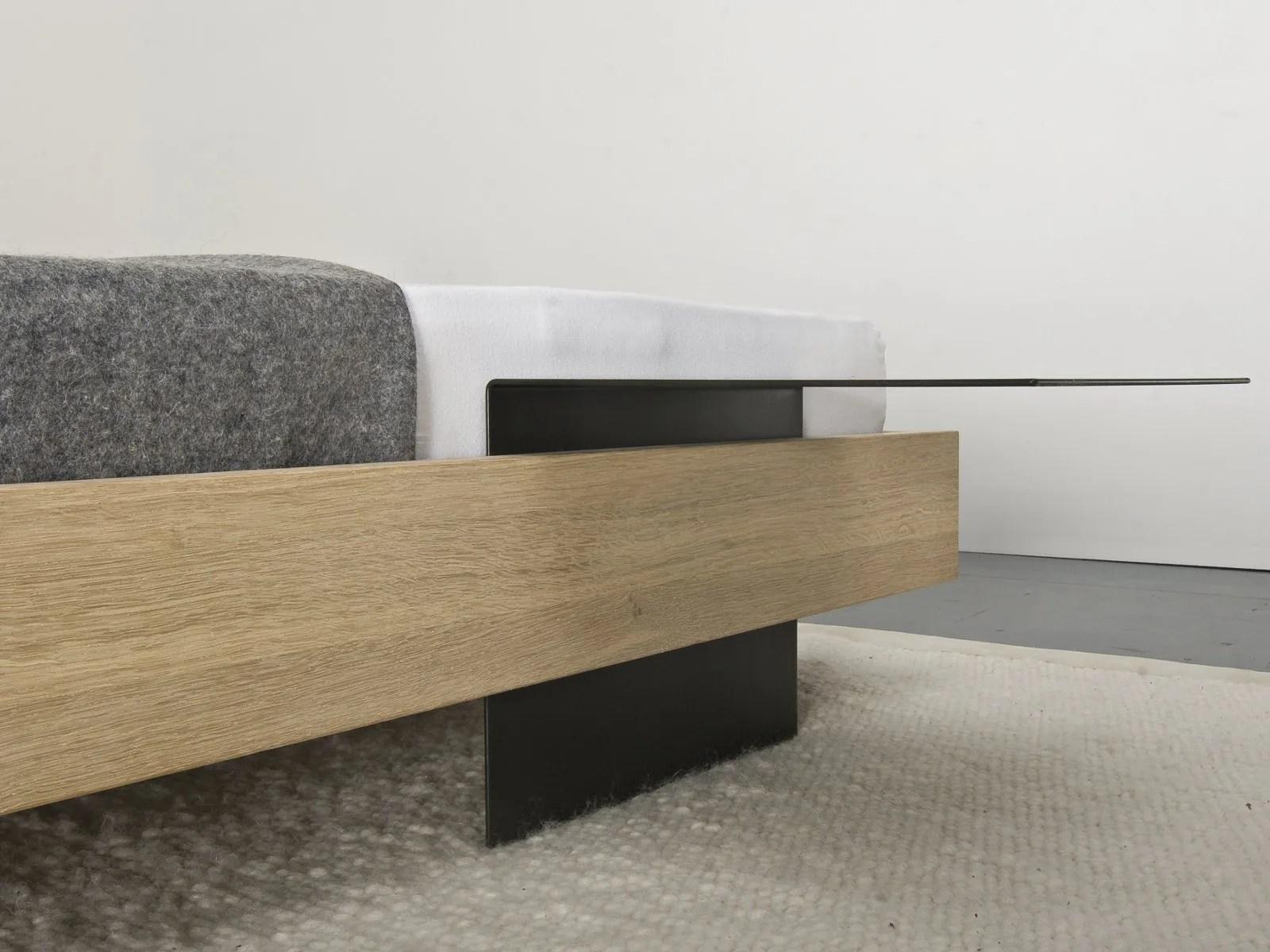 wooden sofa bed curved back modern solid wood iku by sanktjohanser design matthias