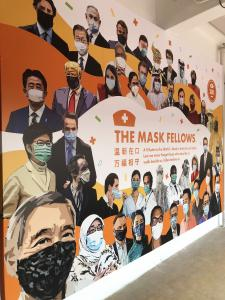 Mask in Unity wall mural featuring world leaders and applauding healthcare workers
