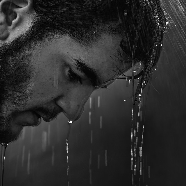 Image result for man crying in the rain