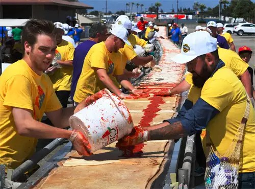 California chefs make the world's longest pizza stretching 6,333 ft!