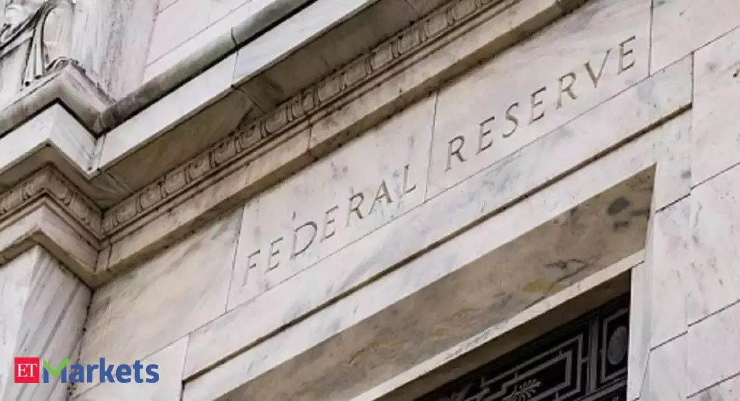 Fed signals rates will stay near zero for at least three years