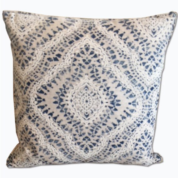 Ivory and blue decorative pillow