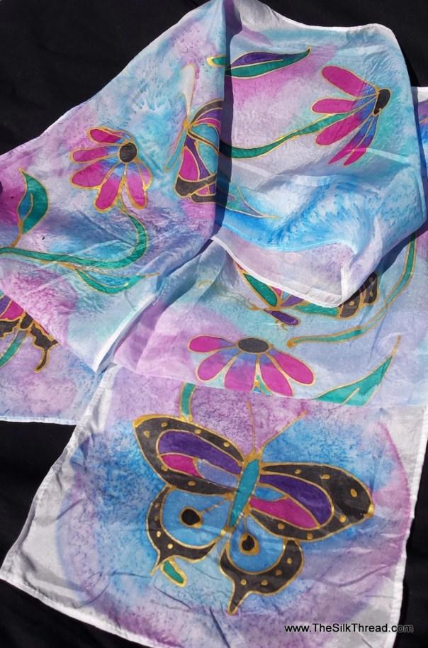 "Butterflies Silk scarf. 8""x54"" custom silk scarf with butterflies & flowers hand drawn in gold by artist M Theresa Brown, blue, purpleround"