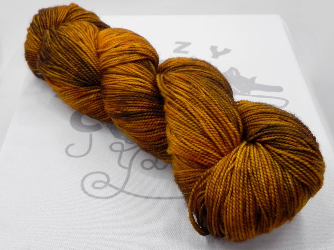 Earthdragon: 400 yards 100% Superwash Merino fingering weight yarn in Elemental yarn base.