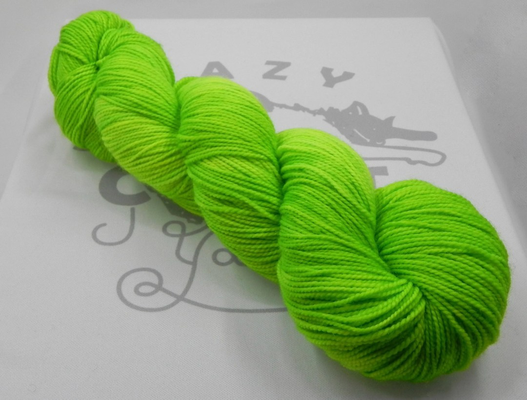 Geiger Counter: 400 yards 100% Superwash Merino fingering weight yarn in Elemental yarn base.