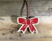 Ceramic Bow Ornament - Pe...
