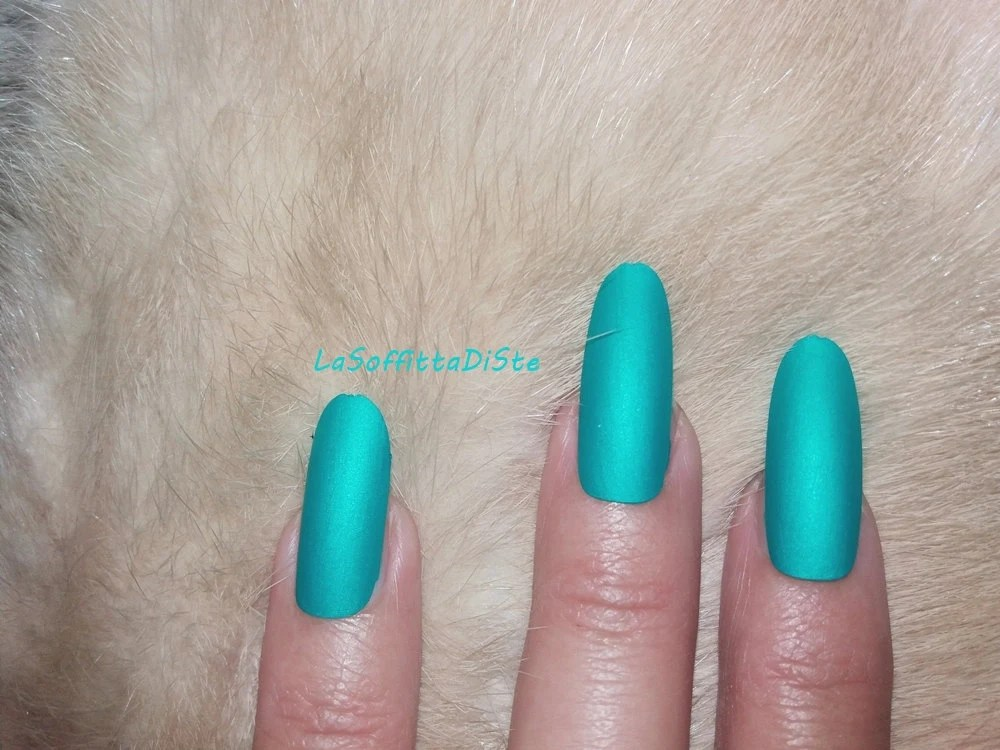 matte turquoise long oval nails