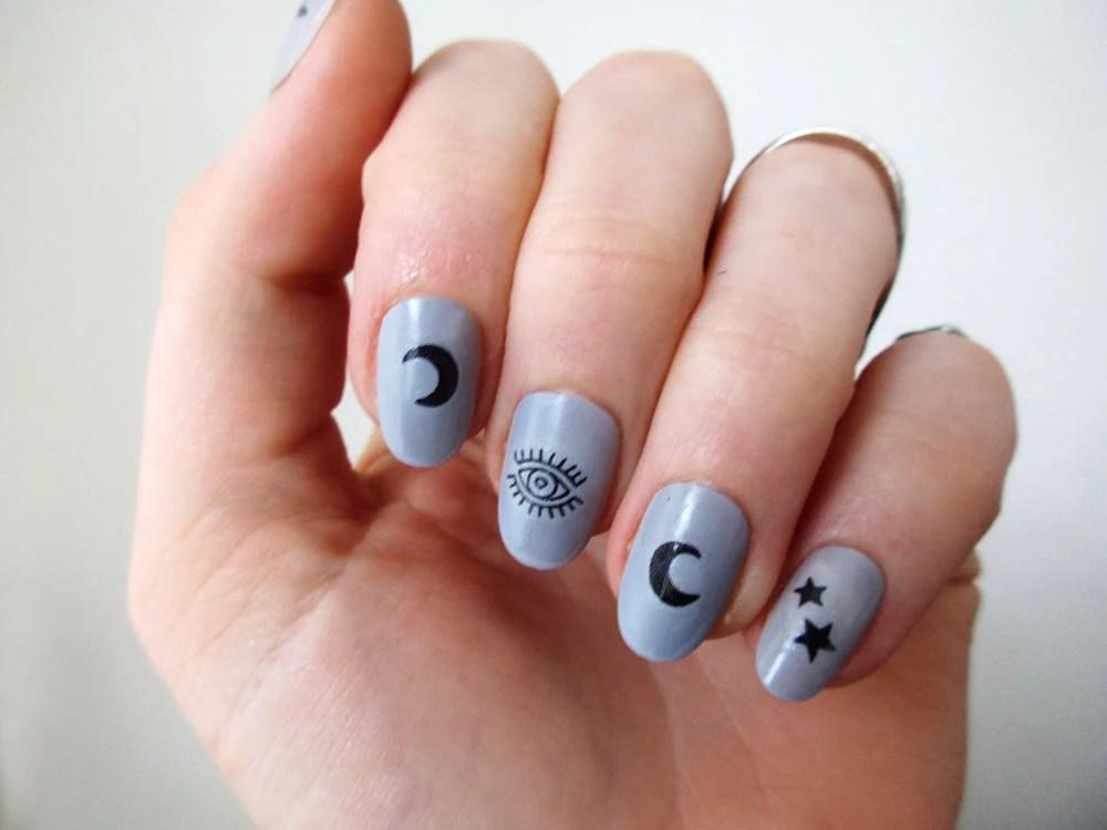 moon stars and eyes nail tattoos