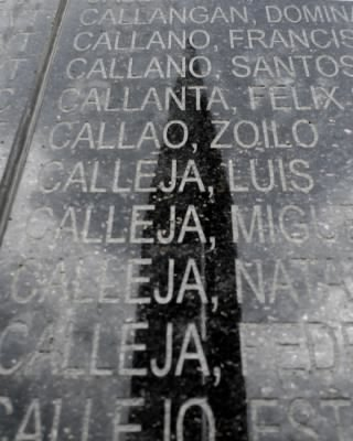 Luis Callej's name appears on the wall of fallen soldiers at the Death March shrine in Capaz, Tarlac, Philippines.