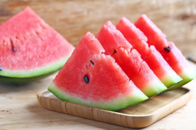 Free Photo   Fresh sliced watermelon on wooden background