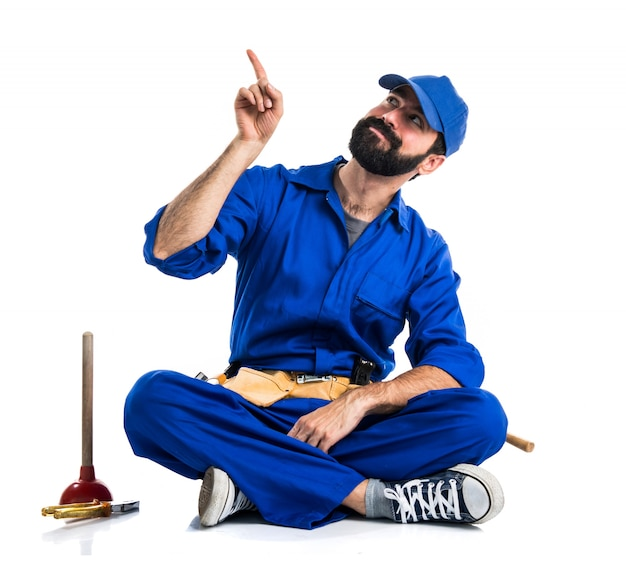 Plumber pointing up