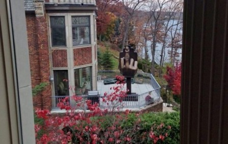 Rich Man Buys House Next to Ex-Wife, Erects Giant Middle Finger Outside