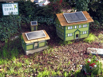 Toad Hollow: a pair of small green houses no more than three feet tall grace the entry to the Davis, CA toad tunnel.
