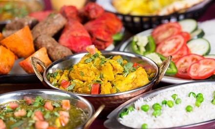 Menu tipico indiano con riso Basmati, dolci e calice di vino Merlot al ristorante Taj Mahal (sconto fino a 68%)