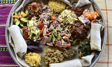 Menu eritreo ed etiope con vino per 2 o 4 persone al Ristorante Asmara zona metro Castro Pretorio (sconto fino a 72%)
