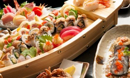 Menu sushi con barca da 36 o 72 pezzi e calice di vino per 2 o 4 persone al ristorante Zen Sushi (sconto fino a 73%)