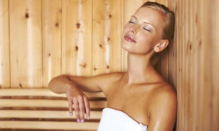Girl enjoying sauna. But does this help you lose weight?