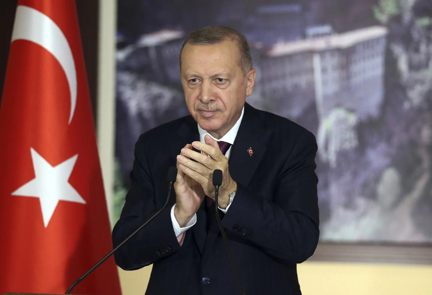 Turkey's President Recep Tayyip Erdogan applauding during a conference in Istanbul, Tuesday, July 28, 2020.