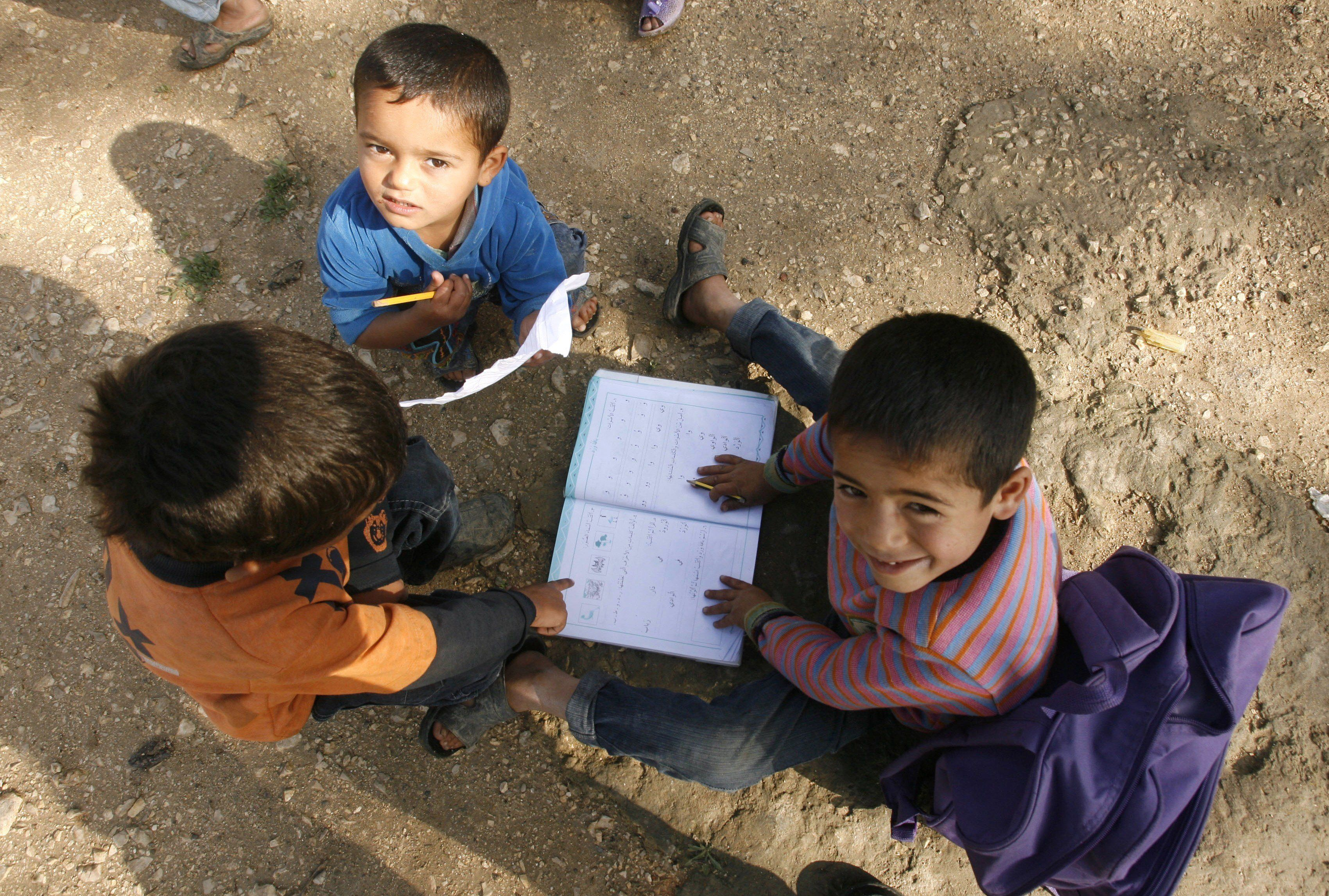 "<span class='image-component__caption' itemprop=""caption"">Boys play with a school book at a UNHCR's camp for Syrian refugees in south Lebanon on April 14, 2015. More than 12 million children in the Middle East are not being educated, despite advances in efforts to expand schooling, the UN children's agency UNICEF said. The figure does not include children forced from school by the conflicts in Syria and Iraq, who would bring the total not receiving an education to 15 million, the agency said in a new report. AFP PHOTO / MAHMOUD ZAYYAT (Photo credit should read MAHMOUD ZAYYAT/AFP/Getty Images)</span>"