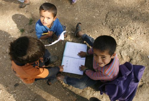 """<span class='image-component__caption' itemprop=""""caption"""">Boys play with a school book at a UNHCR's camp for Syrian refugees in south Lebanon on April 14, 2015. More than 12 million children in the Middle East are not being educated, despite advances in efforts to expand schooling, the UN children's agency UNICEF said. The figure does not include children forced from school by the conflicts in Syria and Iraq, who would bring the total not receiving an education to 15 million, the agency said in a new report. AFP PHOTO / MAHMOUD ZAYYAT (Photo credit should read MAHMOUD ZAYYAT/AFP/Getty Images)</span>"""