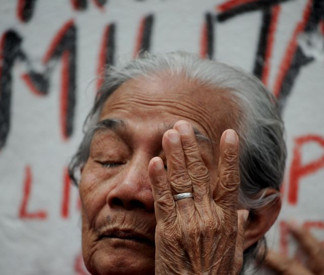 A Filipina Comfort Woman Wipes Away A Tear During A January Protest In