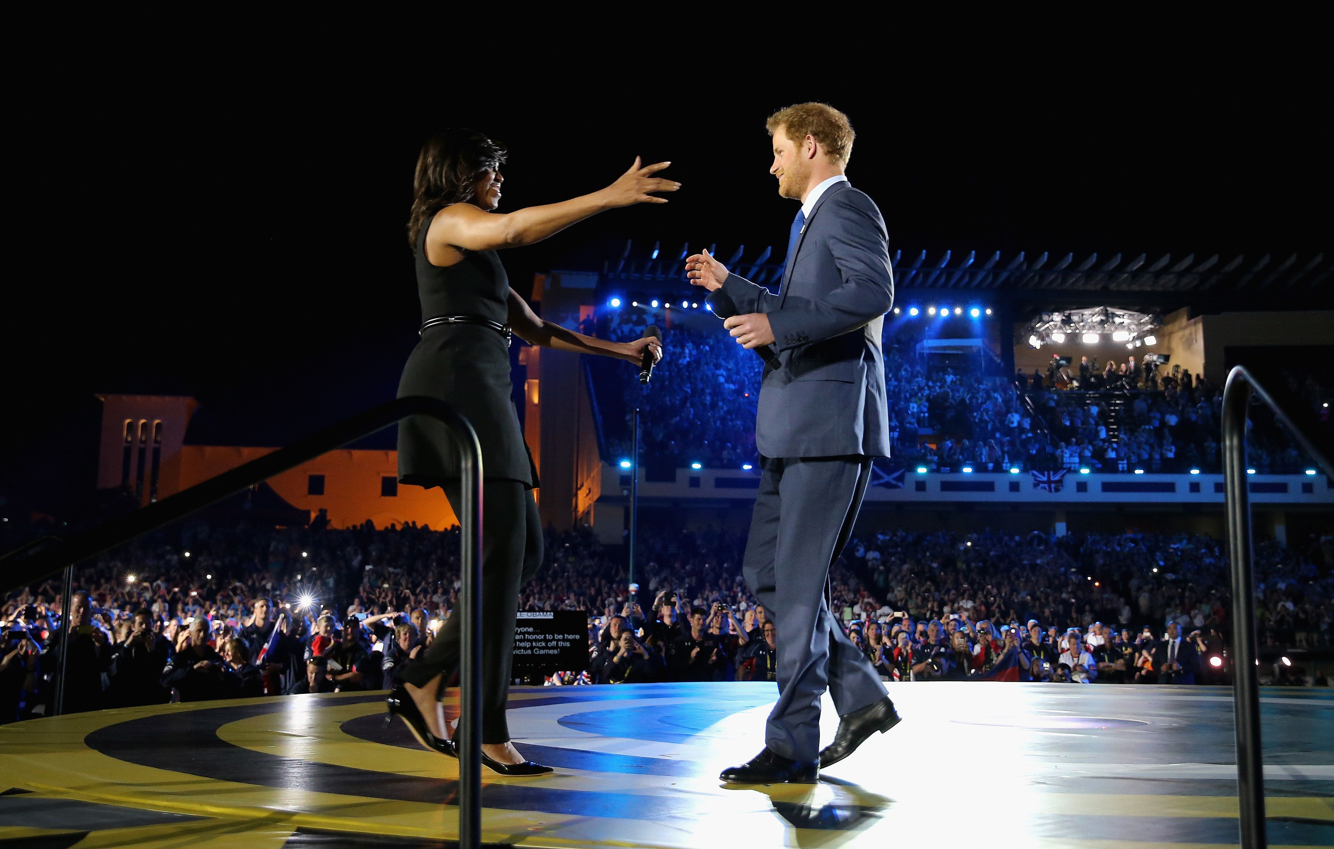 Michelle Obama Goes On A Hugging Spree At The Invictus