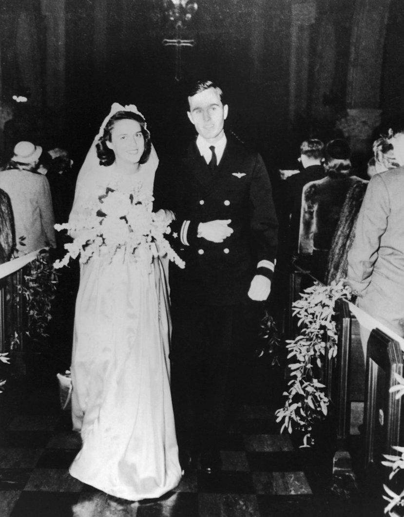 Barbara and George Bush on their wedding day in 1945.