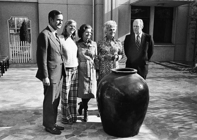 George H.W. Bush, then the U.S. envoy to China, with Susan Ford, Betty Ford, Barbara Bush and then-President Gerald Ford duri