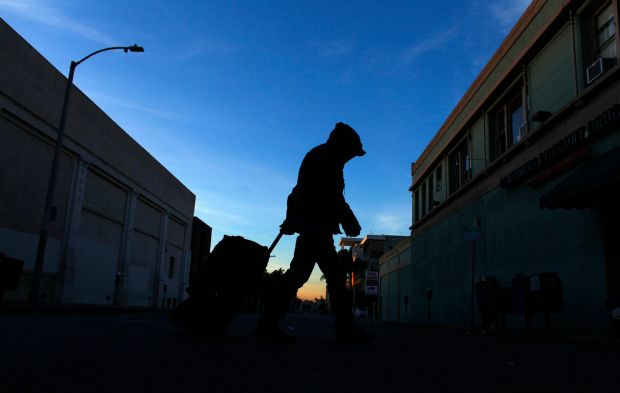A homelessperson makes his way down Los Angeles' Hollywood Boulevard one morning in February 2012.