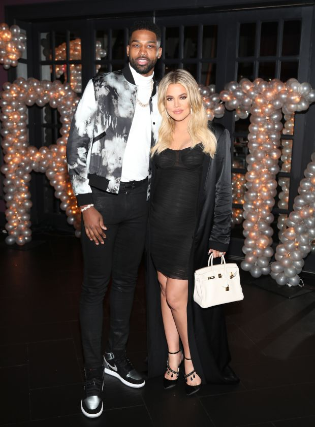 With boyfriend Tristan Thompson at his birthday celebration at Beauty & Essex in Los Angeles.