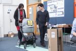 Ramona Williams pushing the Smart Baby Buggy during trials.