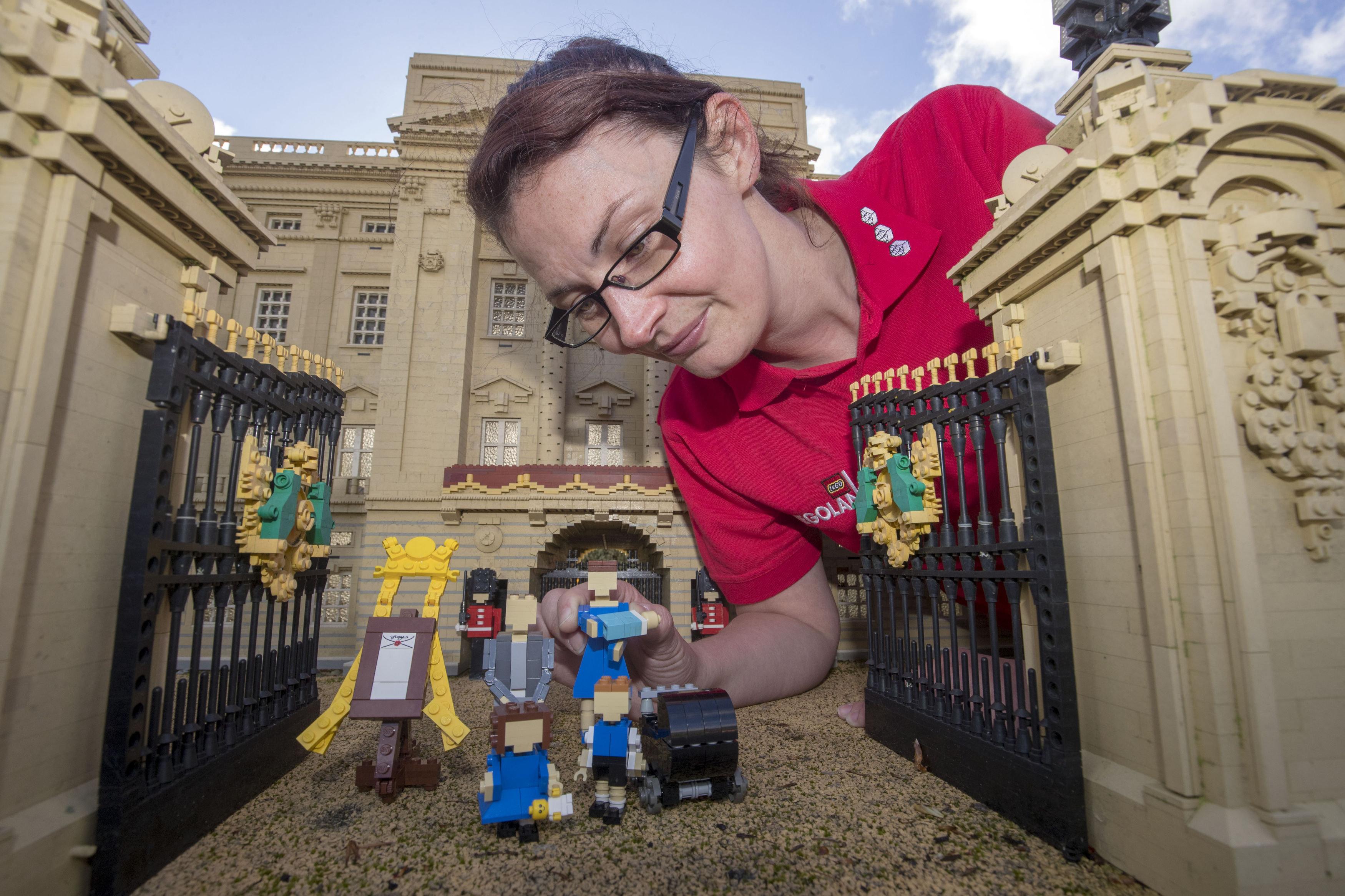 Model maker Kat James puts the finishing toucheson the Lego figures.