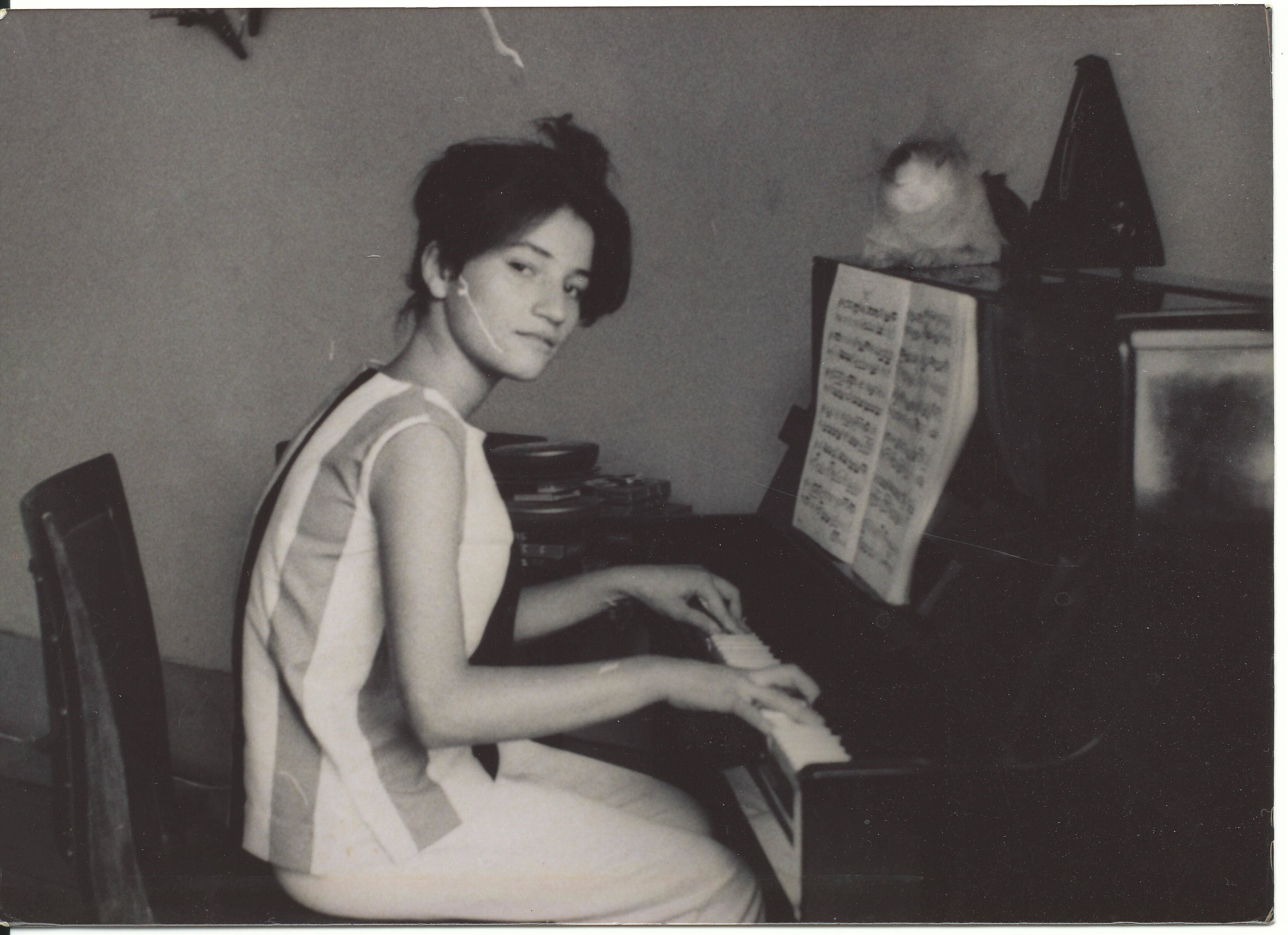 """""""This is my mother at her piano back home in Iraq in 1962. Her name is Shamiran Gabriel."""" -- <i>Ramsin</i>"""