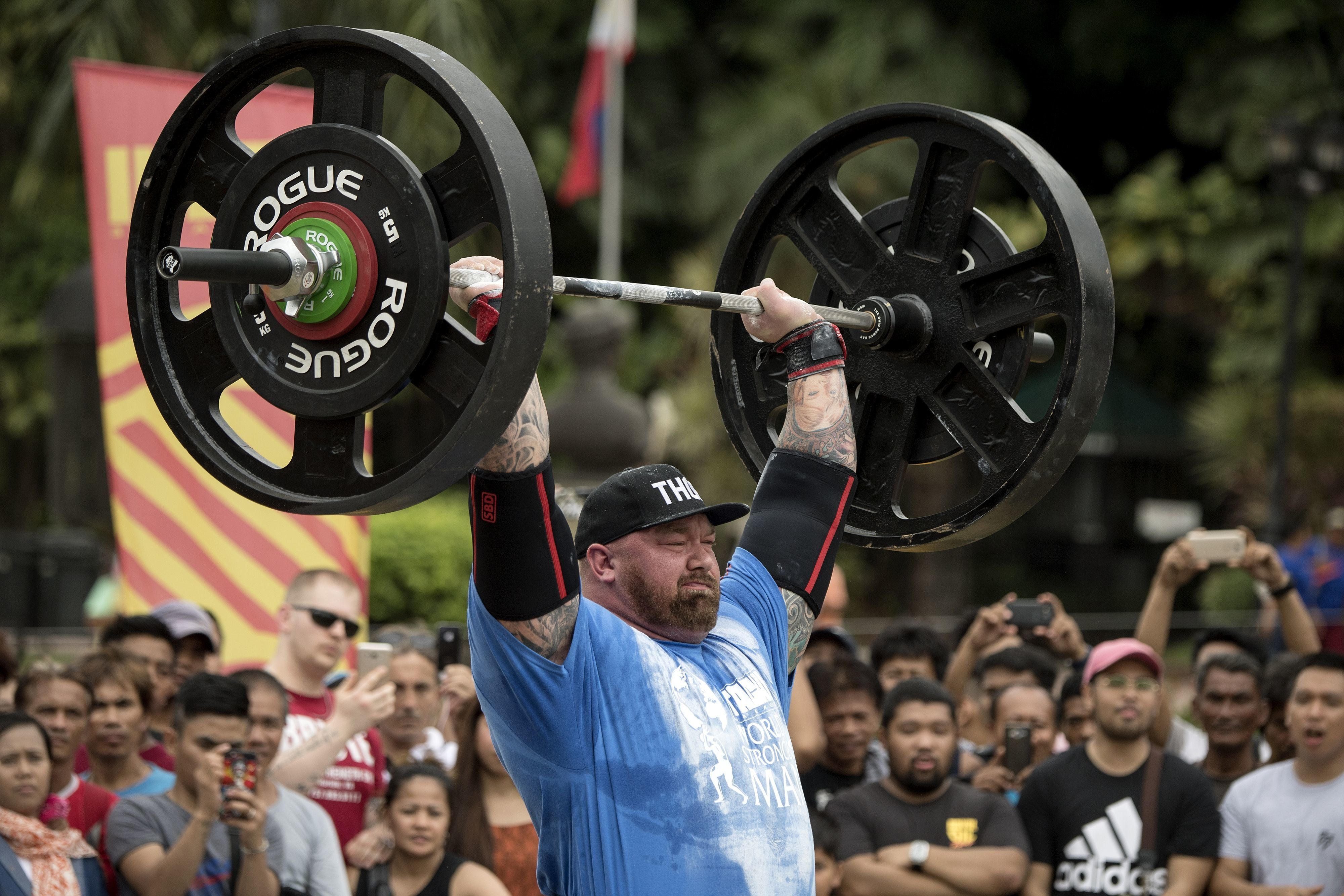 Björnsson lifts weights during the Max Overhead competition.