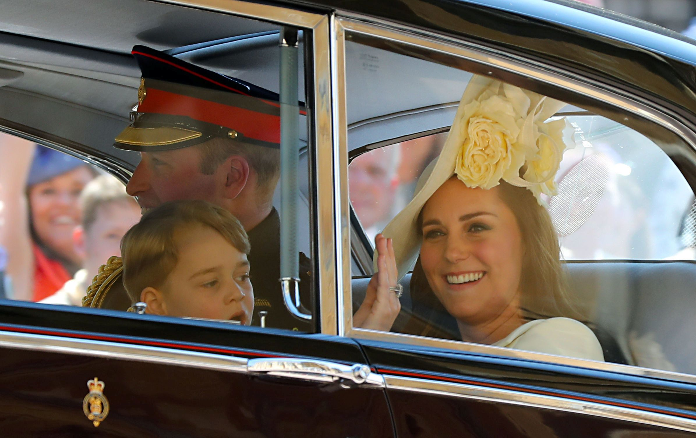 The Duke and Duchess of Cambridge and Prince George leave St George's Chapel.