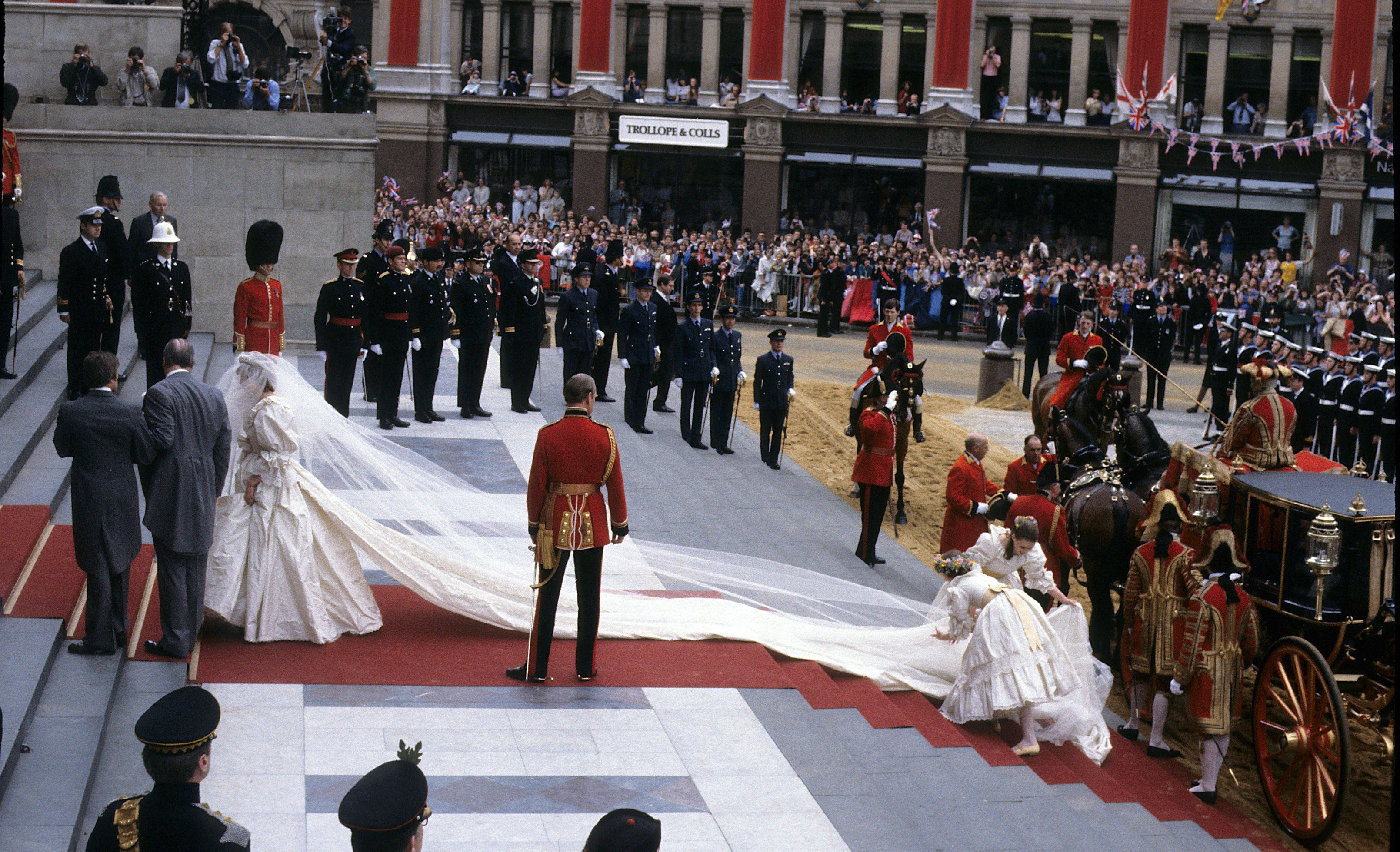 Diana, Princess of Wales, wearing an Emanuel wedding dress, enters St. Paul's Cathedral on the hand of her father, Earl Spenc