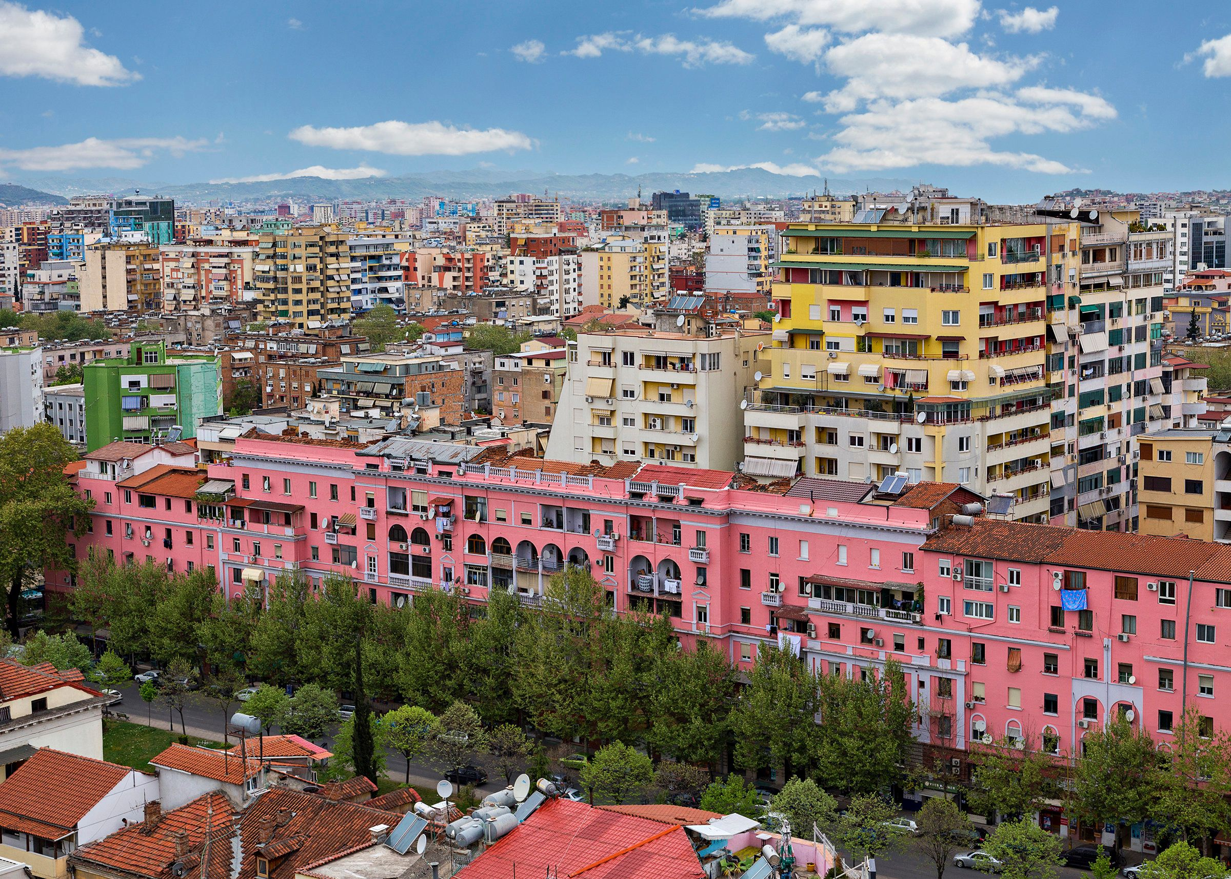 """<a href=""""https://www.lonelyplanet.com/albania/tirana/travel-tips-and-articles/history-and-hedonism-in-tirana/40625c8c-8a11-57"""