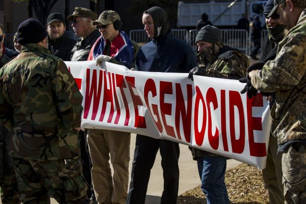 A group of neo-Nazis holds up a banner on Jan. 6 to protest the removal of two Confederate monuments in Memphis.