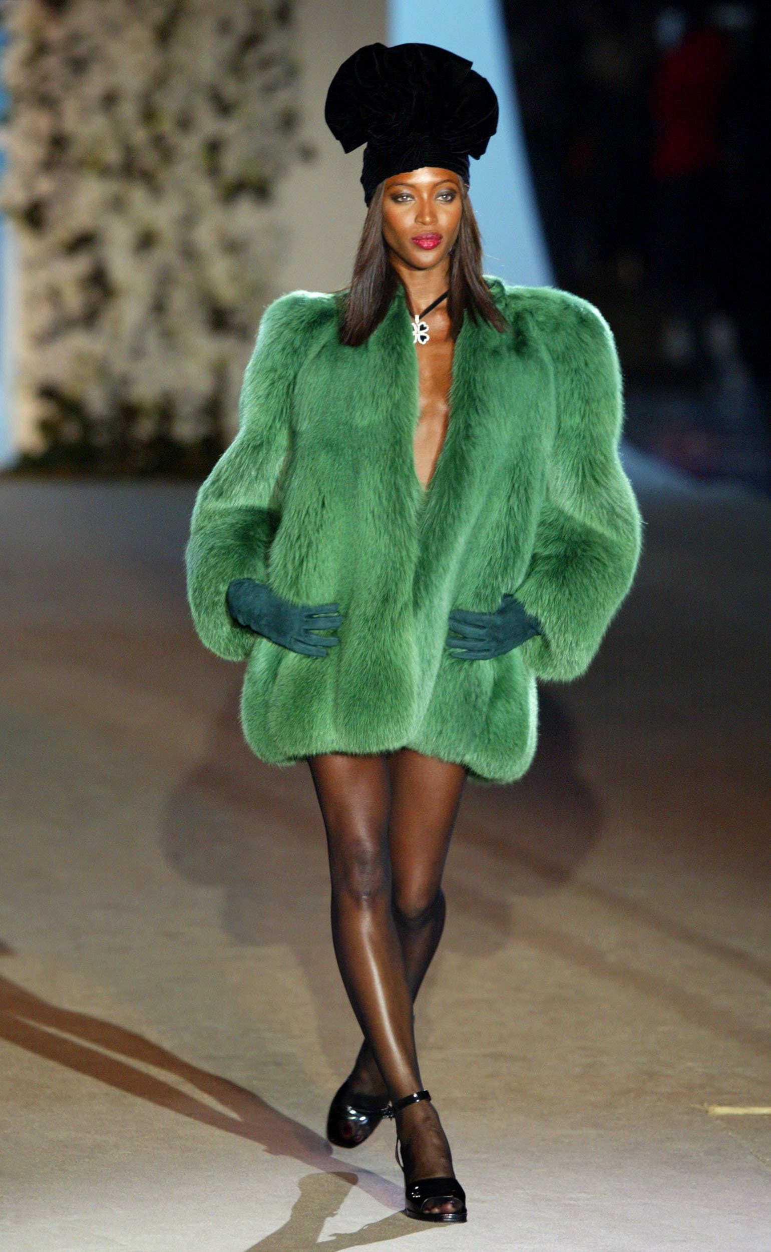 Walking the runway for a Yves Saint Laurent show in Paris, during a retrospective for the designer.