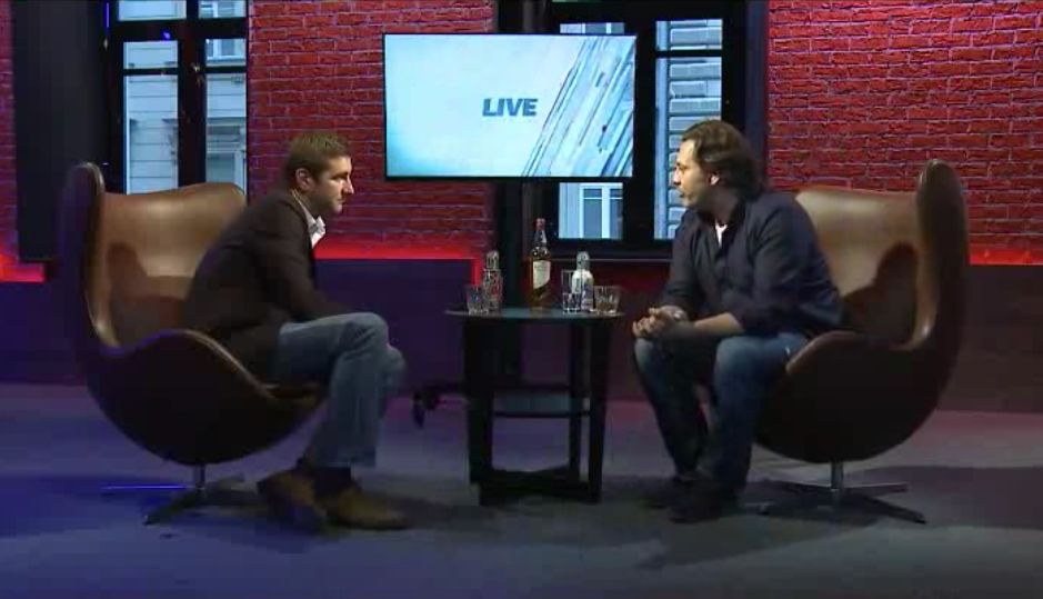 Anton Krasovsky talks to a guest at the studio.